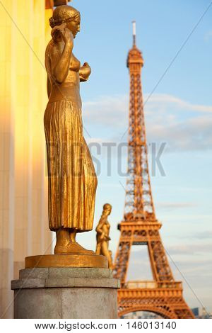 Eiffel Tower from Trocadero at sunset - everything seems golden including the Eiffel Tower itself