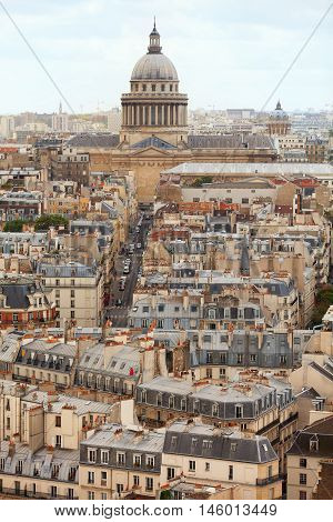 Paris skyline and rooftops. Shot from Notre Dame cathedral. Sacre Coeur cathedral on background