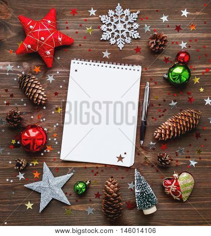 Christmas and New Year background with notepad pen and decorations. To do list or list of promises place for your text. Mock up.