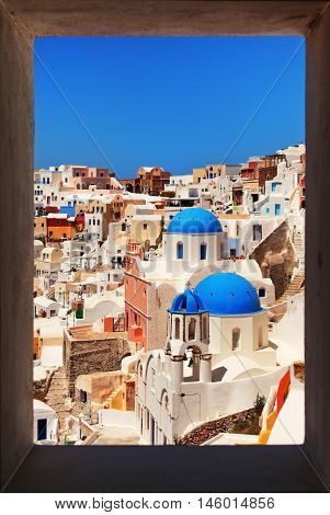 Famous churches of Oia Santorini. Framed view. Vertical shot.