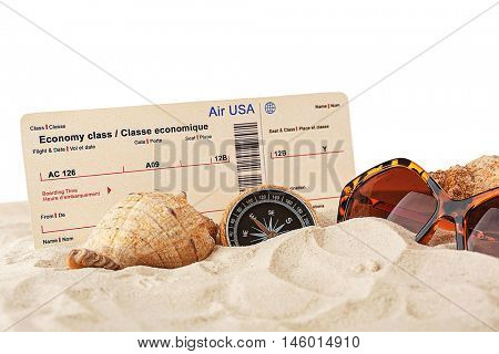 Air ticket and sunglasses on the sand, white background