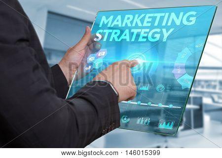 Internet. Business. Technology Concept. Businessman Presses A Button Marketing Strategy On The Virtu