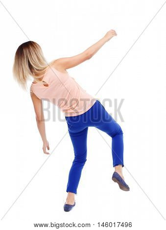 Balancing young woman. or dodge falling woman. Isolated over white background. The blonde in a pink shirt and slipped down.