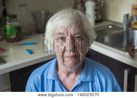 Portrait of Melancholic elderly woman.