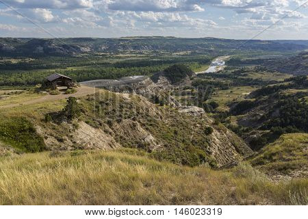 A scenic view of a badlands river valley.
