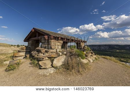 A scenic landscape observation shelter overlooking badlands.