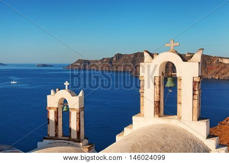 Two churches in Oia Santorini. Detail on crosses and bells