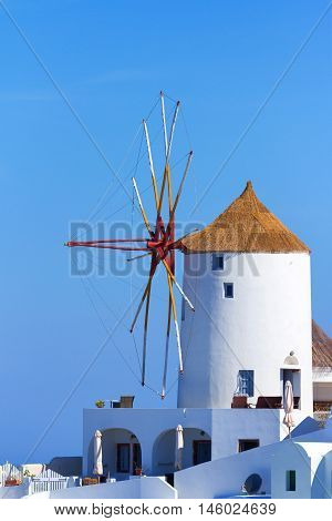 Famous windmill in Oia Santorini shot in the morning at sunrise