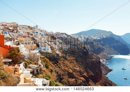 Day panorama of Oia Santorini with mediterranean sea and caldera on background