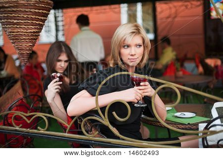 Two Young Women At Sidewalk Cafe