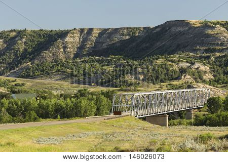 A highway crossing a bridge in the badlands.