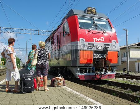 Lazarevskoe, Russia - July 02, 2014: Passengers on the platform of the station Lazarevskoye Sochii expected arrival of the train