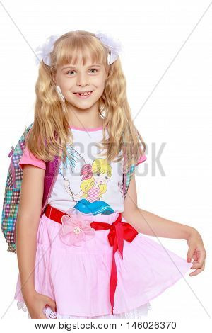 Cheerful little girl in a pink short skirt with a knapsack on his shoulders. Close-up-Isolated on white background