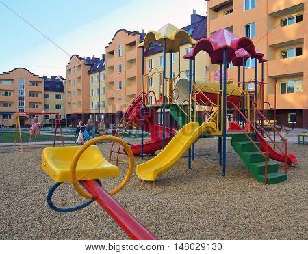 Yartsevo, Russia - July 27, 2014: Children's playground in the yard of the new house