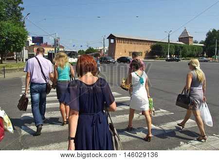 Smolensk, Russia - July 29, 2014: Residents of the city crossing the street at a pedestrian crossing