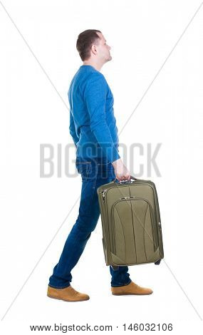 back view of walking  man  with suitcase.  brunette guy in motion. backside view of person.  Rear view people collection. Isolated over white background. young man goes to side of a rolling travel bag