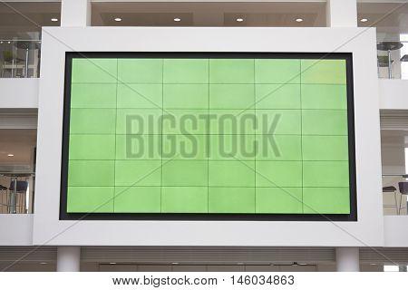 Big screen, AV monitor, in a university lobby atrium