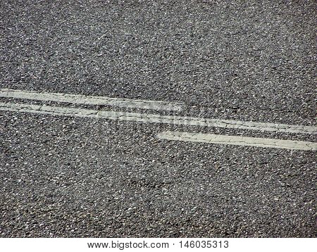 Tar Road detail with white markings -