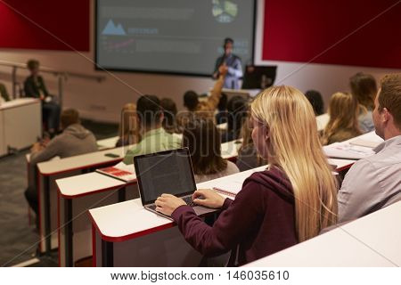 Adult student using laptop computer at a university lecture