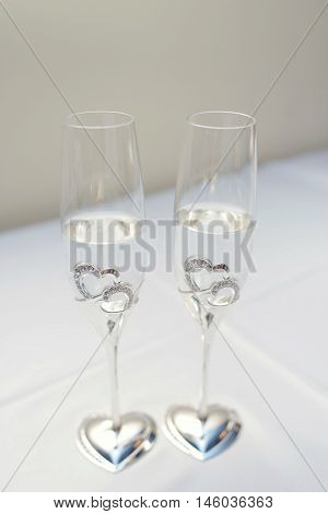 Beautiful wedding champagne and beverage for bride and groom indoors. Colorful couple glasses for alcohol. Beauty of bridal interior for marriage. Bright bar for celebration