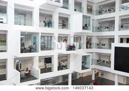 Wide view of students in study cubicles in modern university