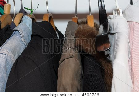 clothes on a hanger in the wardrobe