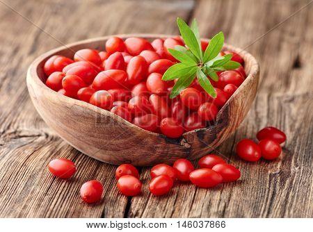 Goji berries on a wooden board