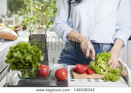 Close-up of a man cutting vegetables in pieces