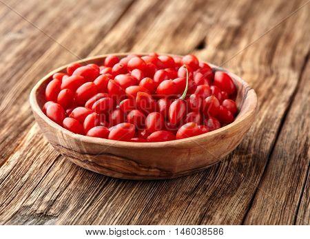 Goji berries in a wooden plate