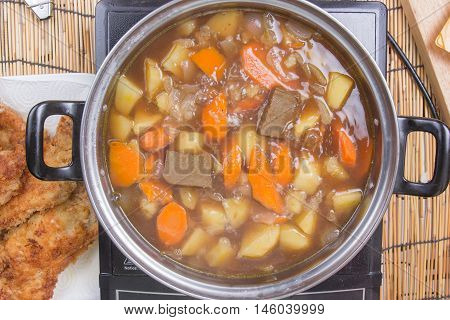 Chef putting Japanese curry pasted for cooking / cooking Japanese pork curry paste concept