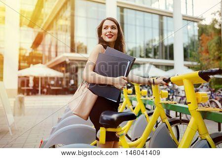 Woman using solar city bike lowering emissions