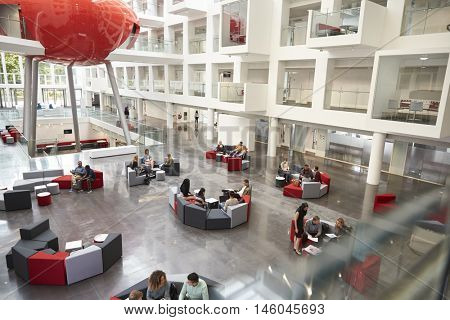 Students in a modern university atrium, view from mezzanine