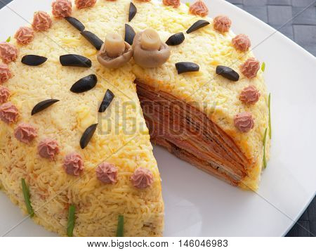 One piece missing from homemade salty pancake cake with ham mushrooms olives and mayonnaise