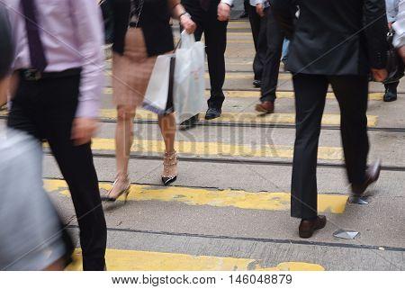 A pedestrian walking along busy street in Hong Kong