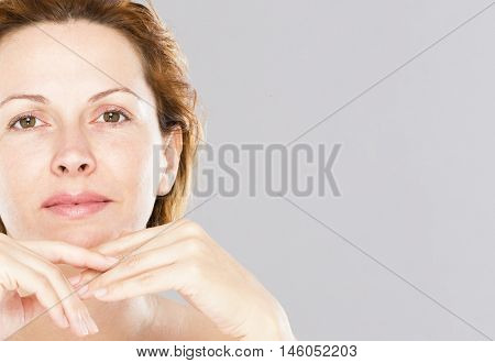 Forty years old woman face and care