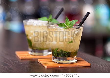 Two cocktails Mint Julep on a bar counter. Horizontal shot