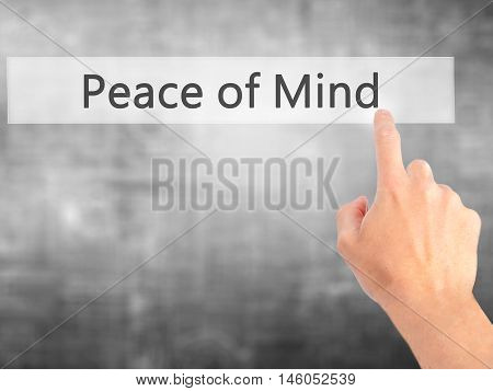Peace Of Mind - Hand Pressing A Button On Blurred Background Concept On Visual Screen.