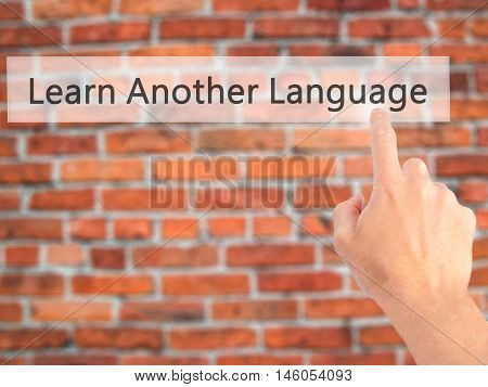 Learn Another Language - Hand Pressing A Button On Blurred Background Concept On Visual Screen.
