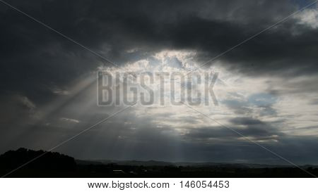 Sun shining through the clouds after a storm