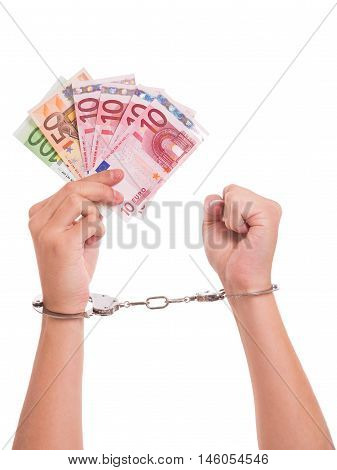 Hands handcuffs and Euro notes - conceptual shot around cunterfeit money