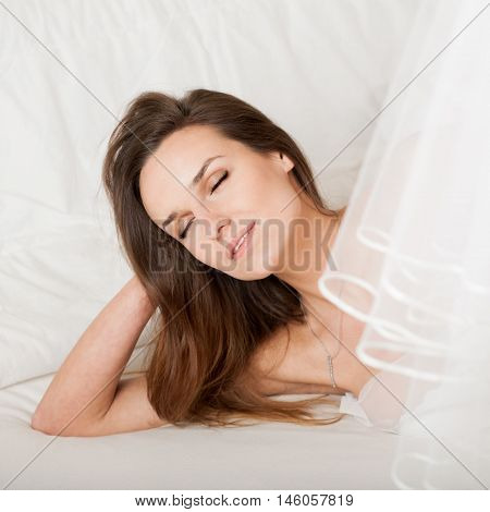 Sensual Girl Lying In Bed At Early Morning