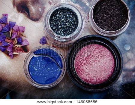 different rouge and eye shadow in colorful background
