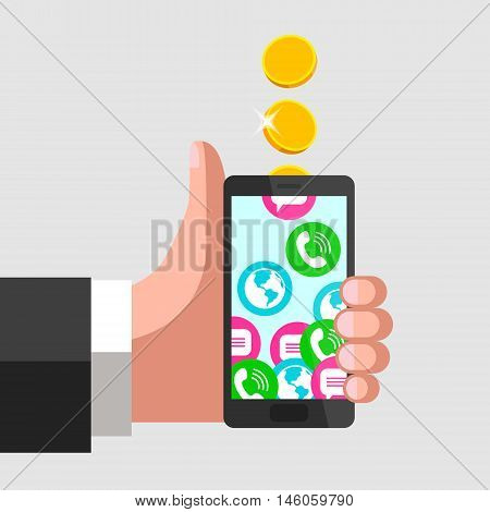 Human hand is keeping mobile phone and giving a thumbs-up at the same time. Gold coins fall into mobile phone turning into calls, sms and internet access. Mobile communication and service payment