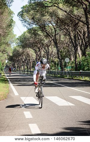 Grosseto, Italy - May 09, 2014: The cyclist without an arm and feet with the bike during sporting event
