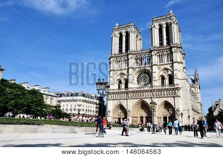 PARIS FRANCE - MAY 7: Undefined people walking near cathedral of Notre Dame Paris on May 7 2011. Paris is the capital and largest city of France