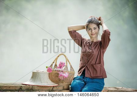 Beautiful Asian Woman Dressed In Traditional Costume Of Thailand