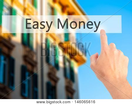 Easy Money - Hand Pressing A Button On Blurred Background Concept On Visual Screen.