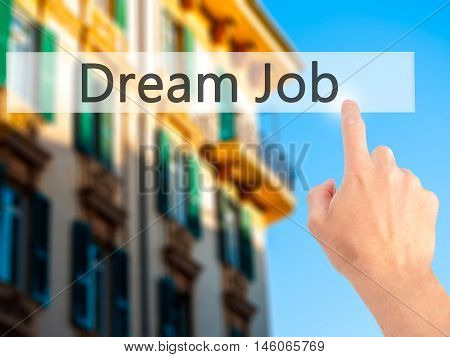 Dream Job - Hand Pressing A Button On Blurred Background Concept On Visual Screen.