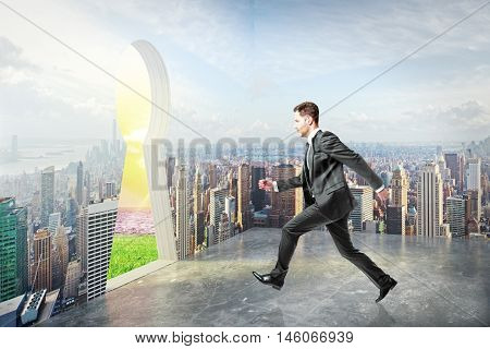 Businessman in city running towards abstract keyhole opening leading to nature. Escape concept