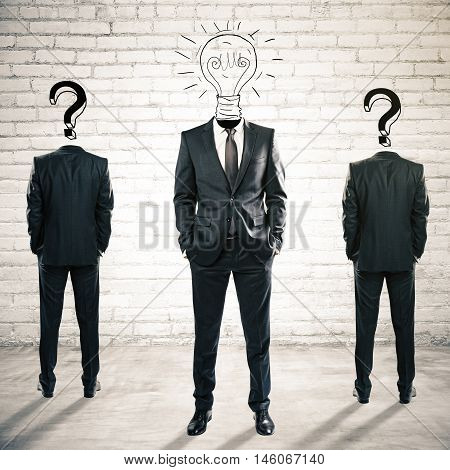 Two question mark headed businesspeople behind light bulb headed man on white brick background. Idea and leadership concept